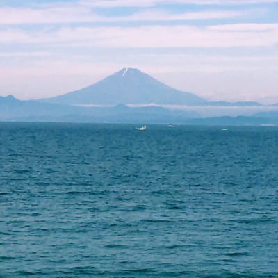 Mount Fuji seen from the coast of Hayama, Kanagawa prefecture on a rare sunny day during the rainy season